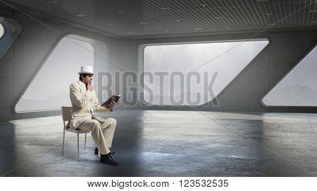 Pensive man read book