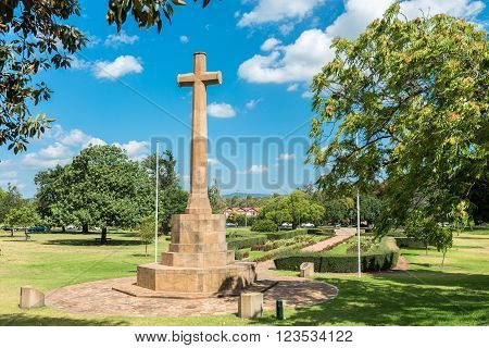 Adelaide Australia - January 3 2016: Cross of Sacrifice Memorial Gardens on a bright day. It is a part of the Women's War Memorial and stands opposite St Peter's Cathedral in the Pennington Gardens
