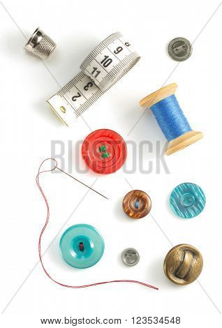sewing tools and accessories isolated on white background