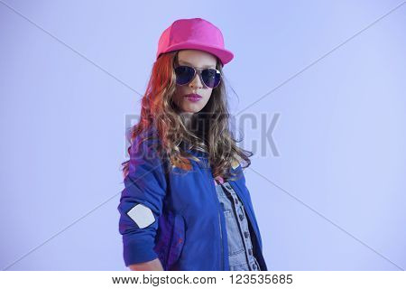 pop style caucasian girl on a blue background