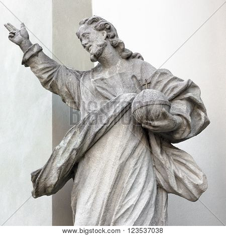 Statue of God; in his hand he holds the planet Earth.