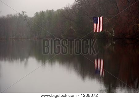American Flag Floats Over Pond