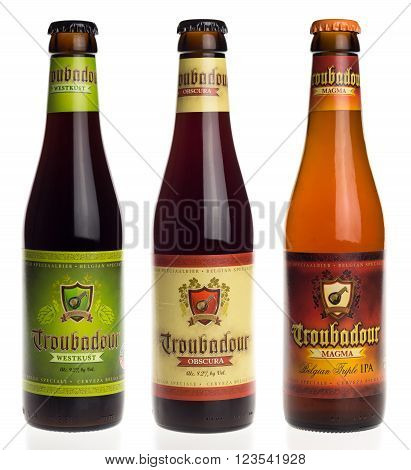 GRONINGEN, NETHERLANDS - MARCH 24, 2016: Belgian beers Troubadour Westkust, Obscura and Magma isolated on a white background