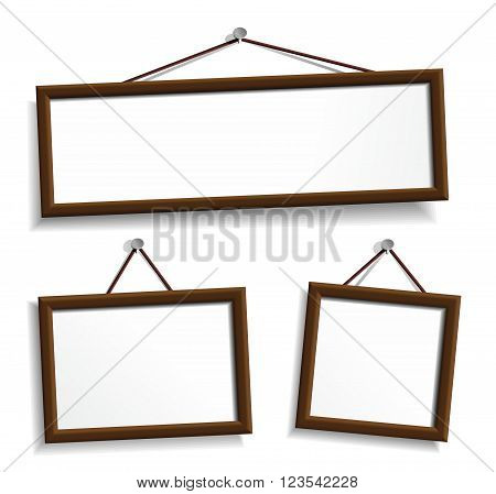 Wooden frames hanging on a nails. Vector design elements isolated on white.