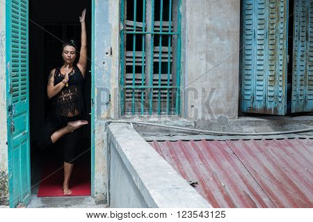 Young Canadian woman practicing asana in doorway