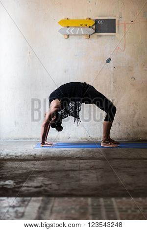 Yogi on elevated bow pose, side view