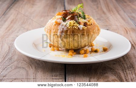 Rajasthani Shahi Raj Kachori, stuffed katchori with potato and sprout filling and served with curd, chutney and sev