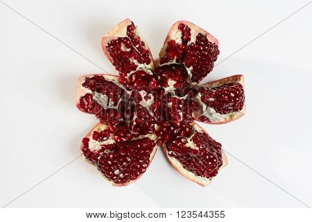 Garnet red sweet ripe. Opened raw fruit.
