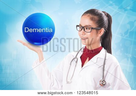 Female doctor holding blue crystal ball with dementia sign on medical background.