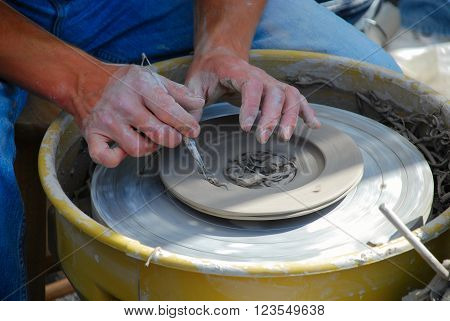 Hands of master doing pottery, Illinois, USA