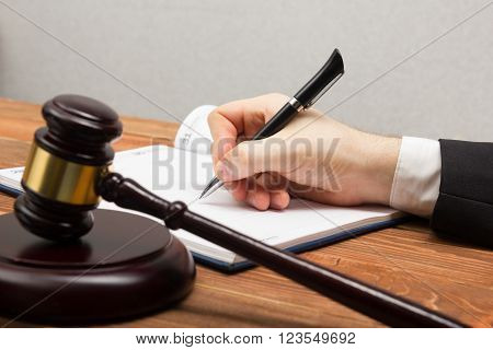 Lawyer working. Notary public signing document at his workplace