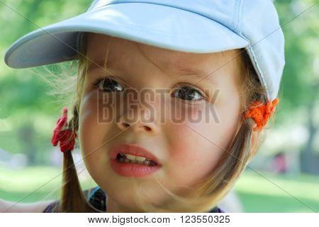 Inquiring look of a little cute girl