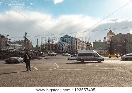 Moscow, Russia - March 20, 2016: Kremlin traffic controller costs on descent at Bolshoy Kamenny Bridge near the Kremlin.