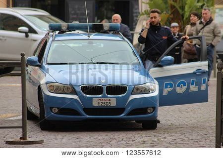 San Remo Italy - March 20 2016: Italian Policeman with a BMW car in the Streets of San Remo. City on the Mediterranean Coast of western Liguria in north-western Italy