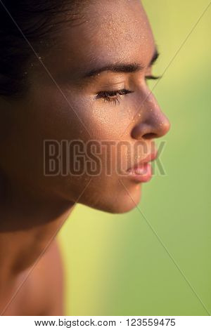 Profile of young caucasian wet woman