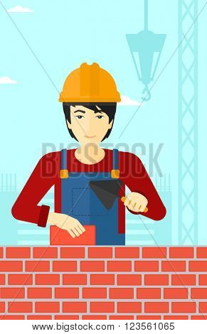 Bricklayer with spatula and brick.