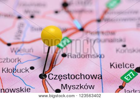 Photo of pinned Czestochowa on a map of Poland. May be used as illustration for traveling theme.