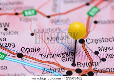 Photo of pinned Tarnowskie Gory on a map of Poland. May be used as illustration for traveling theme.