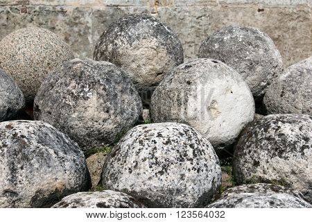 Old cannonballs. Core of ancient tools. Historical sites fortress Velikiy Novgorod, Russia. Stone cannon. Rare weapons of the Slavic wars.