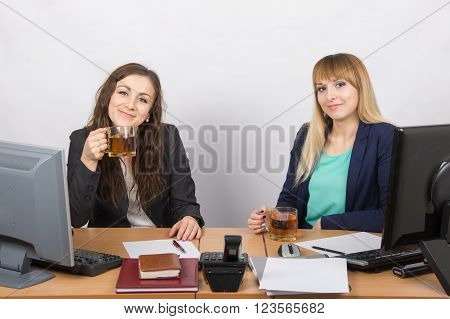 Two Girls Drink Tea, Office Behind A Desk