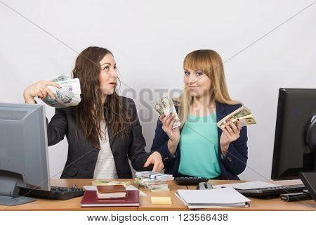 Two Happy Girls Boast Office Bundles Of Money