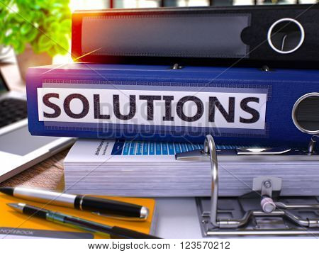 Solutions - Blue Ring Binder on Office Desktop with Office Supplies and Modern Laptop. Solutions Business Concept on Blurred Background. Solutions - Toned Illustration. 3D Render.