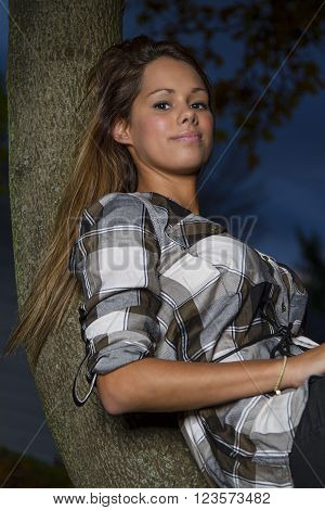 Cute Girl On A Branch