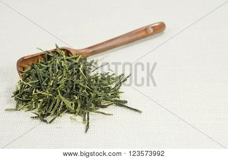 Tea leaf (Sencha) isolated on white background.