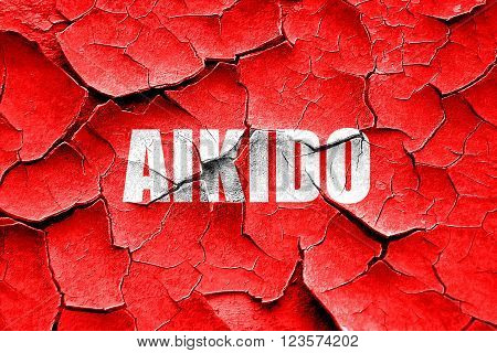 Grunge cracked aikido sign background with some soft smooth lines