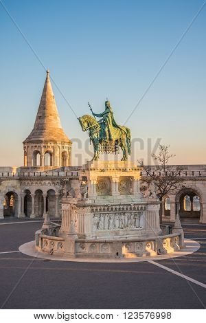 Saint Stefan Statue at Fisherman's Bastion in Budapest Hungary with Clear Blue Sky in Background at Sunrise