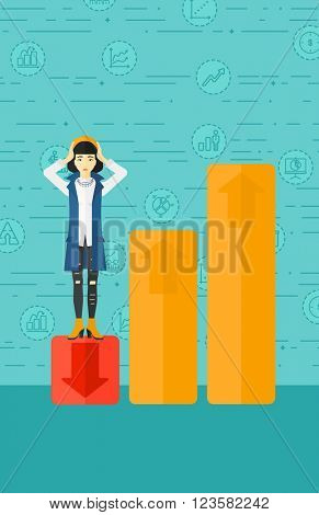 Business woman standing on low graph.