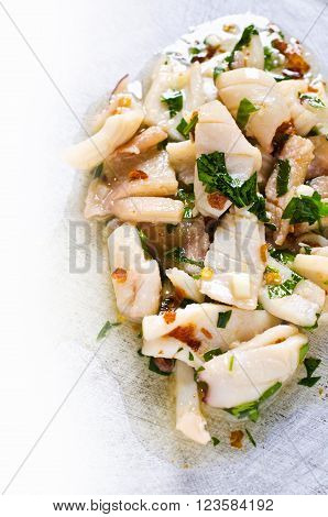 Appetizer of squid in a spicy marinade. Selective focus.