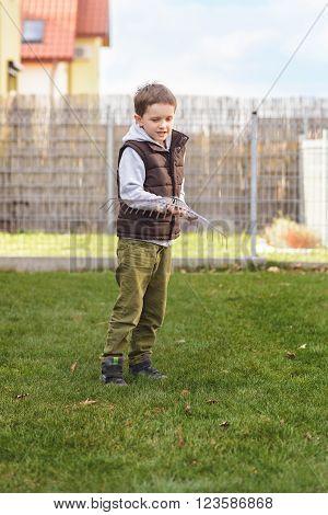 Kid Helping In The Garden.