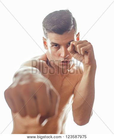 young handsome naked torso man boxing on white background isolated, lifestyle sport agressive people concept