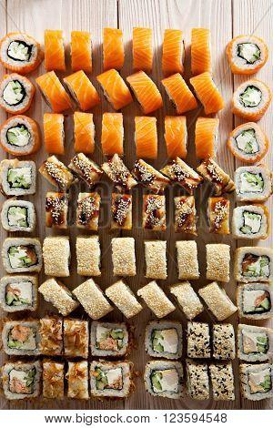 Set of Maki Sushi on Wooden Background