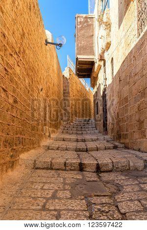 Narrow stone street of old Jaffa in Israel.