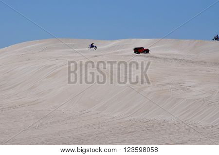 LANCELIN,WA,AUSTRALIA-SEPTEMBER 28,2015: Recreational vehicles riding the white sand dunes on a clear day in Lancelin, Western Australia.