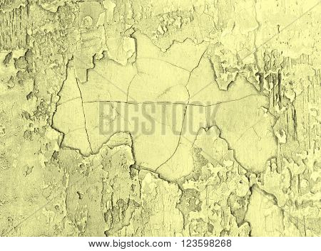 Grey and Yellow Damaged Obsolete Cement Wall Background closeup