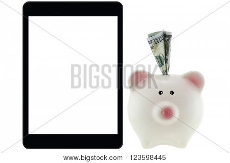 American 100 dollar currency money inside pink piggy bank next to black tablet computer with white blank screen isolated on white