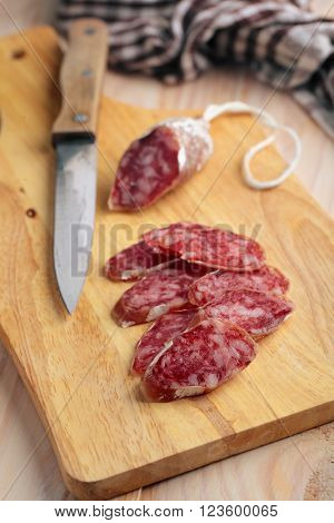 Sliced chorizo sausage on a wooden cutting board