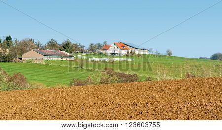 idyllic farm and farmland seen in Southern Germany