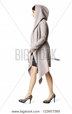 Side view of attractive woman walking. Isolated on white.