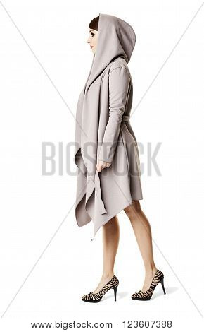Side view of elegant woman walking. Isolated on white background.