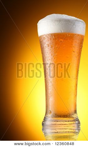 glass of beer on a brown background
