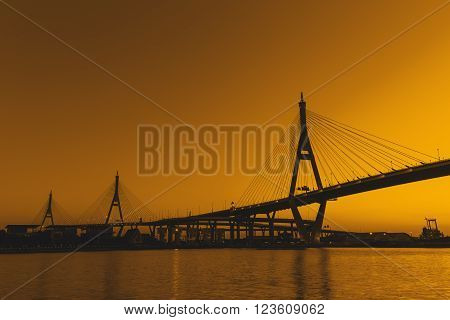 Silhouette Bhumibol Bridge or Industrial Ring Road bridge at twilight