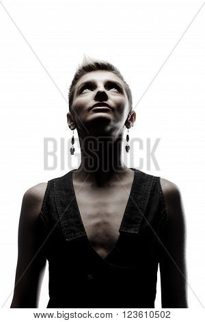 skinny girl with short hair and earrings looking up