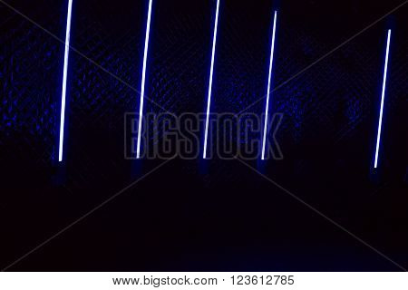 Neon tube light colored night disco black background