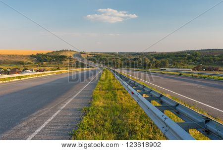 Evening landscape with high-way near Dnepropetrosk city in central Ukraine