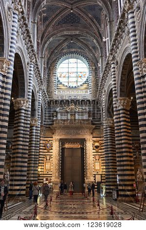 Siena Italy - Febuary 16 2016: Interior of Duomo di Siena (Santa Maria Assunta) a medieval church built in the Romanesque and Italian Gothic style between 1215 and 1263.
