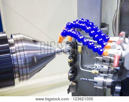 Operator machining automotive part by cnc turning machine